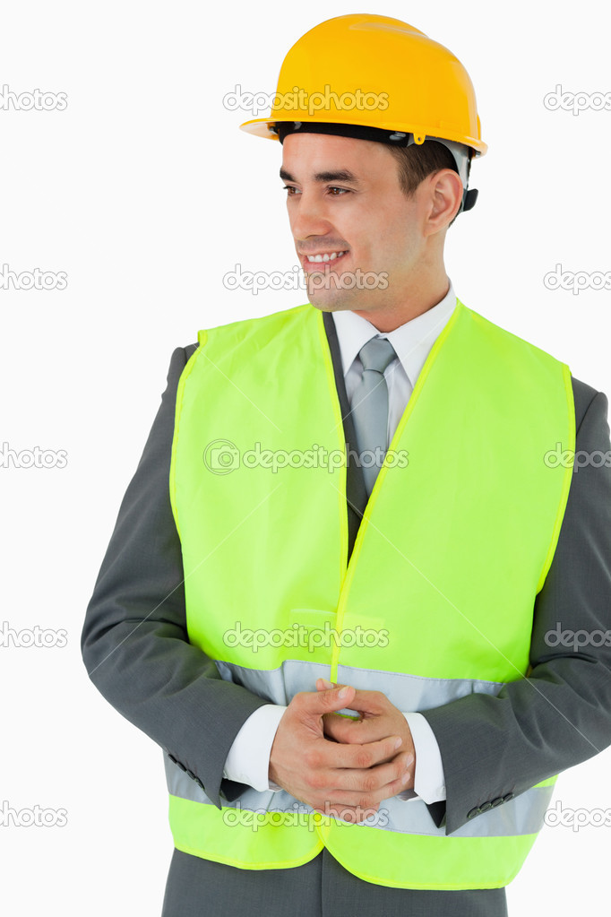 Architect with hands folded looking to the side against a white background — Stock Photo #11199349