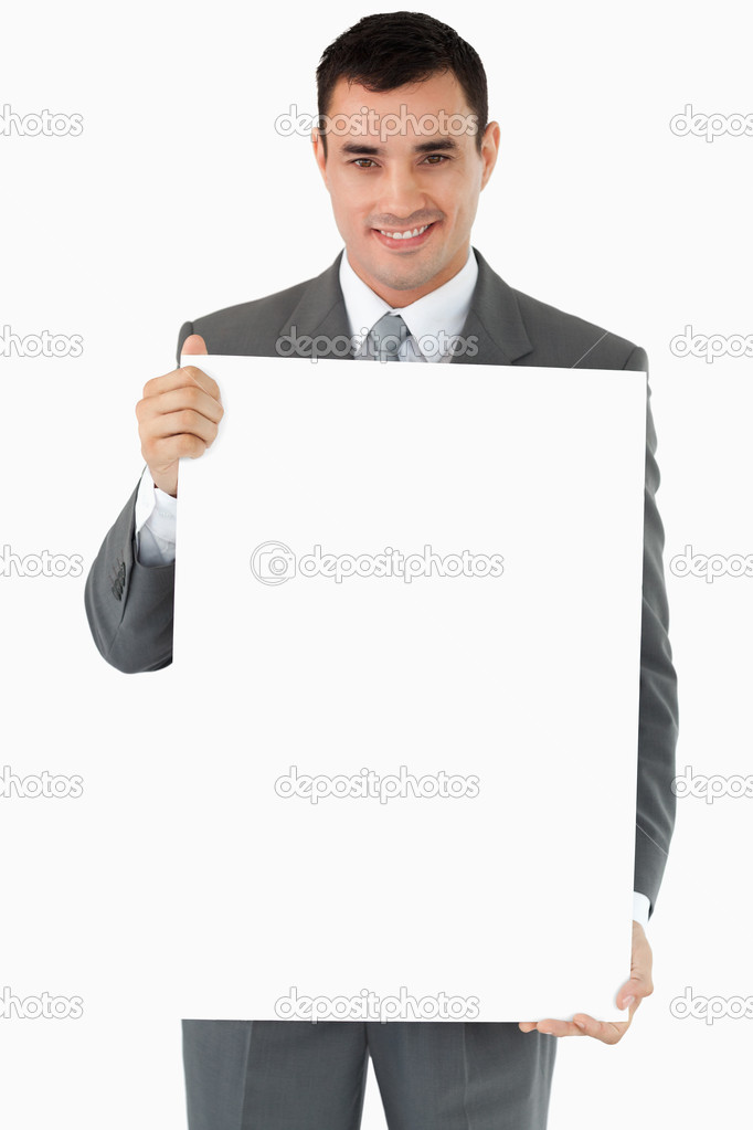 Businessman presenting sign against a white background  Stock Photo #11199361