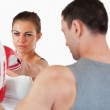 Young female with her martial arts trainer — Stock Photo
