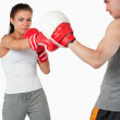 Young female boxer practicing — Stock Photo