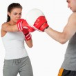 Young female boxer focused on her target — Stock Photo