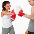Female boxer listening to her instructor — Stock Photo