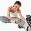 Young woman getting warmed up before workout — Stock Photo