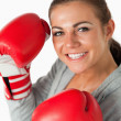 Stock Photo: Portrait of smiling womwith boxing gloves