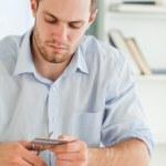 Businessman cutting his credit card — Stock Photo