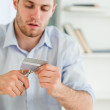 Businessman getting rid of his credit card — Stock Photo