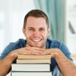 Smiling student with his books — Stock Photo