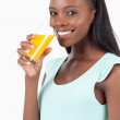 Side view of smiling woman with orange juice — Stock Photo