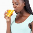 Side view of young woman drinking orange juice — Stock Photo