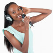 Happy smiling young woman singing - Stock Photo