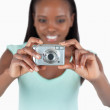 Digi cam being used by smiling woman — Stock Photo #11202117