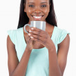 Smiling young woman with a cup of coffee — Stock Photo