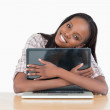 Young woman hugging her laptop — Stock Photo #11202629