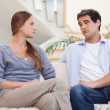 Stock Photo: Young couple having an argument while watching TV