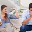 Man being tired of arguing with his wife - Foto Stock
