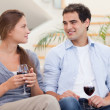 Couple having a glass of red wine — Stock Photo