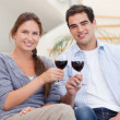 Young couple having a glass of red wine — Stock Photo