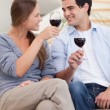 Portrait of a couple having a glass of red wine — Stock Photo