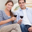 Portrait of a young couple having a glass of red wine — Stock Photo