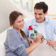 Man offering a rose to his fiance — Stock Photo #11204302