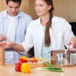 Cute couple using a tablet computer to cook — Stock Photo #11204516