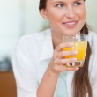 Portrait of a happy woman drinking juice — Stock Photo
