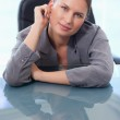 Portrait of a businesswoman leaning on her desk — Stock Photo #11204758