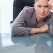 Portrait of a bored businesswoman leaning on her desk — Stock Photo #11204765