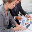 Portrait of a young business team studying statistics — Stock Photo