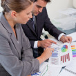 Portrait of an attractive business team studying statistics — Stock Photo #11204797
