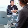 Portrait of a manager interviewing a female applicant — Stock Photo #11204812
