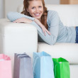 Woman taking a rest on the sofa after shopping tour — Stock Photo