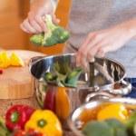 Woman preparing vegetable soup — Stock Photo