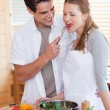 Stock Photo: Couple enjoys being in kitchen together