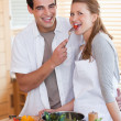 Stock Photo: Couple enjoys preparing lunch together