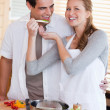 Stock Photo: Couple enjoys preparing dinner together