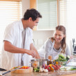 Couple using the internet to look up recipe — Stock Photo