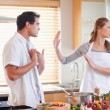 Stock Photo: Couple arguing in the kitchen