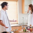 Stock Photo: Couple disputing in the kitchen