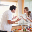 Stock Photo: Couple having fight in kitchen