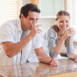 Stock Photo: Couple drinking milk in kitchen