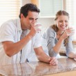 Couple drinking milk in the kitchen — Stock Photo