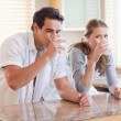 Couple enjoying some milk in the kitchen — Stock Photo