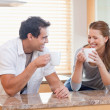 Couple having some coffee in the kitchen — Stock Photo