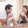 Couple having some coffee in the kitchen — Stockfoto