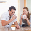 Couple having tea in the kitchen — Stock Photo