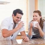 Couple having tea in the kitchen — Stock Photo