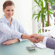 Consultant shaking hands with her client — Stock Photo