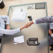 Above view of consultant shaking hands with customer — Stock Photo