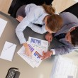 Above view of consultant analyzing statistics with her client — Stock Photo #11205303